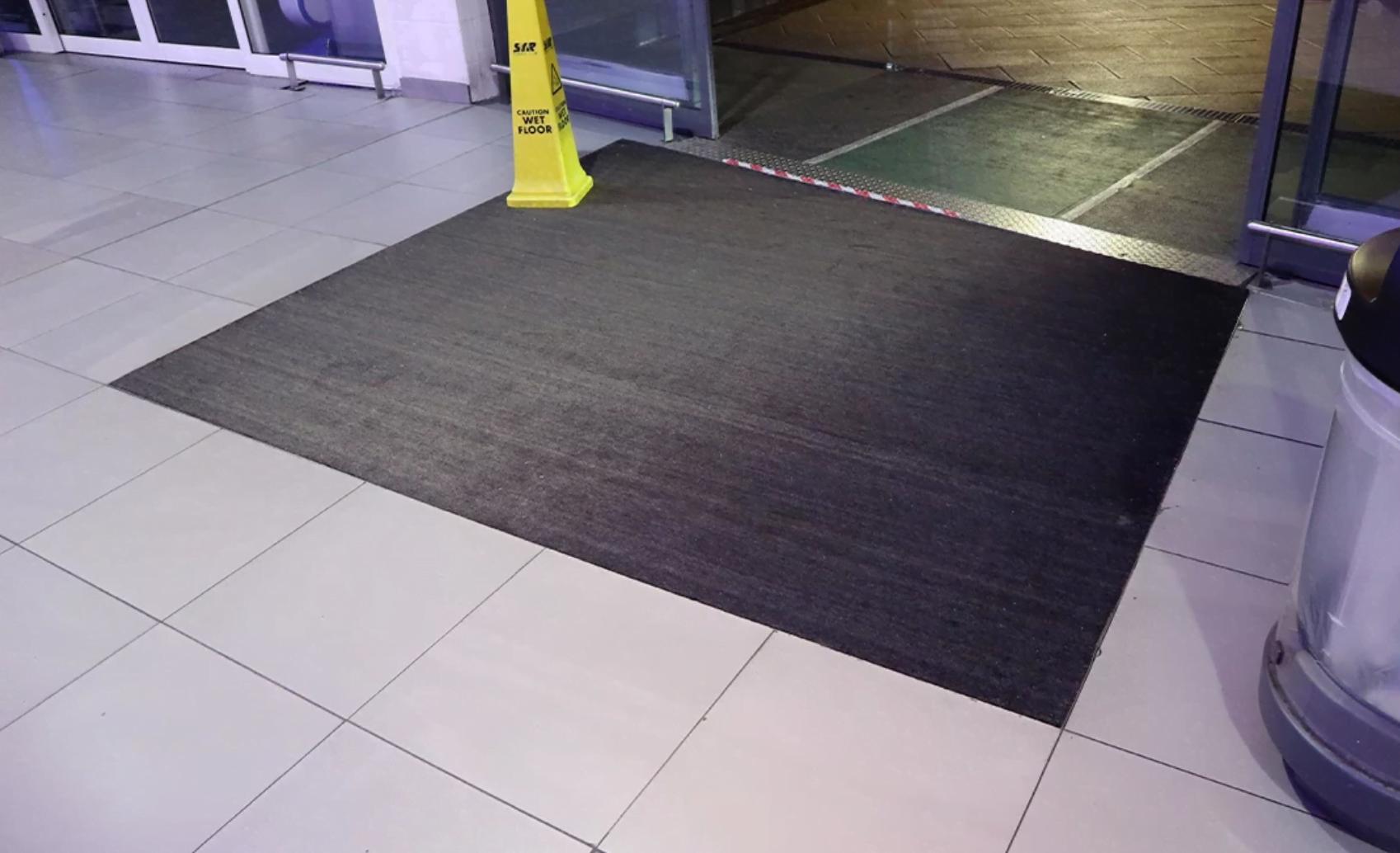before entrance matting